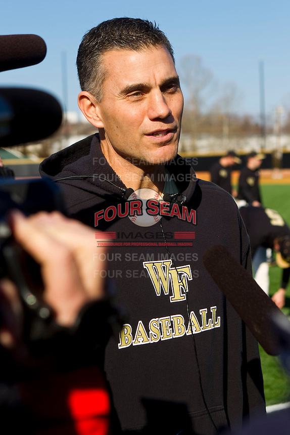 Wake Forest Demon Deacons head baseball coach Tom Walter speaks with the media prior to batting practice at Wake Forest Baseball Park on February 11, 2011 in Winston-Salem, North Carolina.  Just four days earlier Coach Walter donated one of his kidneys to Kevin Jordan, a freshman on the baseball team.  Photo by Brian Westerholt / Four Seam Images