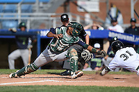 Vermont Lake Monsters catcher Andy Paz (35) attempts to tag Francisco Aponte (31) sliding in safely during a game against the Jamestown Jammers on July 13, 2014 at Russell Diethrick Park in Jamestown, New York.  Jamestown defeated Vermont 6-2.  (Mike Janes/Four Seam Images)