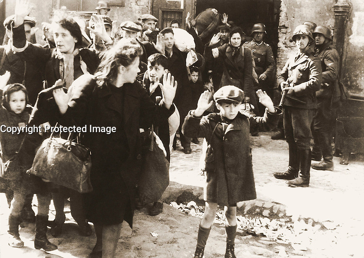1943/04/19 - 1943/05/16 - Photo from J&cedil;rgen Stroop Report to Heinrich Himmler from May 1943. The original German caption reads: &quot;Forcibly pulled out of dug-outs&quot;. One of the most famous pictures of World War II. People recognized in the picture:<br /> <br />     * Boy in the front was not recognized, some possible identities: Artur Dab Siemiatek, Levi Zelinwarger (next to his mother Chana Zelinwarger) and Tsvi Nussbaum.<br />     * Hanka Lamet - small girl on the left<br />     * Matylda Lamet Goldfinger - Hanka's mother next to her (second from the left)<br />     * Leo Kartuzinski - far back with white bag on his shoulder<br />     * Golda Stavarowski - also in the back, first women from the right, with one hand raised<br />     * Josef Bl&circ;sche - SS man with the gun<br /> <br /> <br /> Deutsch: Aufstand im Warschauer Ghetto &ntilde; Fotografie von J&cedil;rgen Stroop. Aus dem Stroop-Bericht von 1943 an Heinrich Himmler von Mai 1943. Die originale Bildunterschrift lautet &Ntilde;Mit Gewalt aus Bunkern hervorgeholt&igrave;. Es ist eines der bekanntesten Fotos aus dem zweiten Weltkrieg. Auf dem Foto identifizierte Personen:<br /> <br />     * Der Junge im Vordergrund wurde nicht zweifelsfrei wiedererkannt, m&circ;gliche Identit&permil;ten: Artur Dab Siemiatek, Levi Zelinwarger (neben seiner Mutter Chana Zelinwarger) oder Tsvi Nussbaum.<br />     * Hanka Lamet &ntilde; kleines M&permil;dchen links.<br />     * Matylda Lamet Goldfinger &ntilde; Hankas Mutter daneben, 2. von links.<br />     * Leo Kartuzinski &ntilde; Jugendlicher im Hintergrund mit weiflem Sack auf der Schulter.<br />     * Golda Stavarowski &ntilde; im Hintergrund, erste Frau von rechts mit einer erhobenen Hand.<br />     * Josef Bl&circ;sche &ntilde; SS-Mann mit Gewehr, wurde 1969 hingerichtet.<br /> <br /> <br /> Fran&Aacute;ais : Insurrection du Ghetto de Varsovie. Photo extraite du rapport de mai 1943 de J&cedil;rgen Stroop &Dagger; Heinrich Himmler. L&Egrave;gende originale e