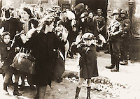 "1943/04/19 - 1943/05/16 - Photo from J¸rgen Stroop Report to Heinrich Himmler from May 1943. The original German caption reads: ""Forcibly pulled out of dug-outs"". One of the most famous pictures of World War II. People recognized in the picture:<br /> <br />     * Boy in the front was not recognized, some possible identities: Artur Dab Siemiatek, Levi Zelinwarger (next to his mother Chana Zelinwarger) and Tsvi Nussbaum.<br />     * Hanka Lamet - small girl on the left<br />     * Matylda Lamet Goldfinger - Hanka's mother next to her (second from the left)<br />     * Leo Kartuzinski - far back with white bag on his shoulder<br />     * Golda Stavarowski - also in the back, first women from the right, with one hand raised<br />     * Josef Blˆsche - SS man with the gun<br /> <br /> <br /> Deutsch: Aufstand im Warschauer Ghetto ñ Fotografie von J¸rgen Stroop. Aus dem Stroop-Bericht von 1943 an Heinrich Himmler von Mai 1943. Die originale Bildunterschrift lautet ÑMit Gewalt aus Bunkern hervorgeholtì. Es ist eines der bekanntesten Fotos aus dem zweiten Weltkrieg. Auf dem Foto identifizierte Personen:<br /> <br />     * Der Junge im Vordergrund wurde nicht zweifelsfrei wiedererkannt, mˆgliche Identit‰ten: Artur Dab Siemiatek, Levi Zelinwarger (neben seiner Mutter Chana Zelinwarger) oder Tsvi Nussbaum.<br />     * Hanka Lamet ñ kleines M‰dchen links.<br />     * Matylda Lamet Goldfinger ñ Hankas Mutter daneben, 2. von links.<br />     * Leo Kartuzinski ñ Jugendlicher im Hintergrund mit weiflem Sack auf der Schulter.<br />     * Golda Stavarowski ñ im Hintergrund, erste Frau von rechts mit einer erhobenen Hand.<br />     * Josef Blˆsche ñ SS-Mann mit Gewehr, wurde 1969 hingerichtet.<br /> <br /> <br /> FranÁais : Insurrection du Ghetto de Varsovie. Photo extraite du rapport de mai 1943 de J¸rgen Stroop ‡ Heinrich Himmler. LÈgende originale en allemand : ´ ForcÈs hors de leurs trous ª. Cette photo est l'une des plus cÈlËbres de la Seconde Guerre mondiale. Certaines des personnes visibles sur cette photo ont ÈtÈ reconnues :<br /> <br />     * Le garÁon au premier plan est p"