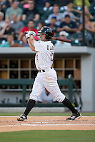 Drew Garcia (2) of the Charlotte Knights follows through on his swing against the Rochester Red Wings at BB&T BallPark on August 8, 2015 in Charlotte, North Carolina.  The Red Wings defeated the Knights 3-0.  (Brian Westerholt/Four Seam Images)