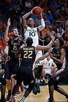 9 January 2016:  Miami guard Sheldon McClellan (10) jumps to pass the ball while being defended by Florida State center Boris Bojanovsky (15), guard Malik Beasley (5) and guard Xavier Rathan-Mayes (22) in the second half as the University of Miami Hurricanes defeated the Florida State Seminoles, 72-59, at BankUnited Center in Coral Gables, Florida. (Photo by Samuel Lewis/Icon Sportswire)