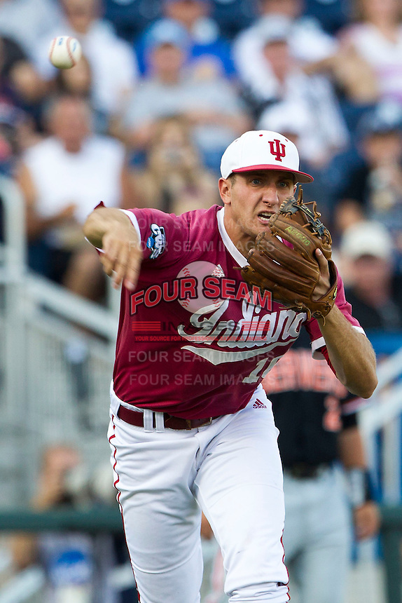 Indiana Hoosiers third baseman Dustin DeMuth (16) makes a throw to first base against the Oregon State Beavers during Game 9 of the 2013 Men's College World Series  on June 19, 2013 at TD Ameritrade Park in Omaha, Nebraska. The Beavers defeated the Hoosiers 1-0, eliminating Indiana from the tournament. (Andrew Woolley/Four Seam Images)