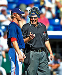 10 March 2009: Home plate umpire Gary Cederstrom chats with Washington Nationals' pitcher Collin Balester between innings of a Spring Training game against the New York Mets at Space Coast Stadium in Viera, Florida. The Nationals and Mets tied 5-5 in the 10-inning Grapefruit League matchup. Mandatory Photo Credit: Ed Wolfstein Photo