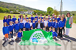 Caherdaniel NS the proud recipients of their first Green flag which was presented to the school on Thursday last and and raised on the flagstaff by Mick O'Dwyer, pictured here pupils and staff with Mick O'Dwyer.