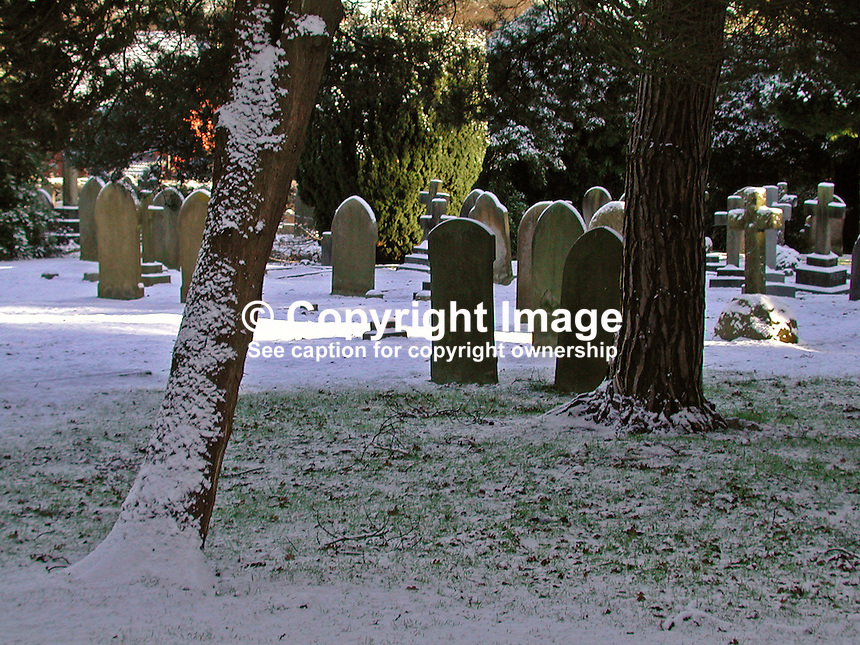 Graveyard snow scene in Farnborough, Hampshire, England, UK,2000121446..Copyright Image from Victor Patterson, 54 Dorchester Park, Belfast, UK, BT9 6RJ..Tel: +44 28 9066 1296.Mob: +44 7802 353836.Voicemail +44 20 8816 7153.Skype: victorpattersonbelfast.Email: victorpatterson@mac.com.Email: victorpatterson@ireland.com (back-up)..IMPORTANT: If you wish to use this image or any other of my images please go to www.victorpatterson.com and click on the Terms & Conditions. Then contact me by email or phone with the reference number(s) of the image(s) concerned.