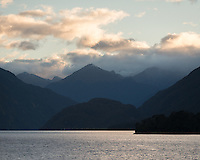 Sunrise over Wilmot Pass as seen from Doubtful Sound, Fiordland National Park, UNESCO World Heritage Area, Southland, New Zealand, NZ