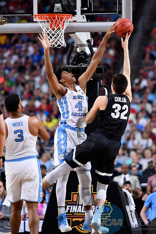 GLENDALE, AZ - APRIL 03: Zach Collins #32 of the Gonzaga Bulldogs shoots a jumper over Isaiah Hicks #4 of the North Carolina Tar Heels during the 2017 NCAA Men's Final Four National Championship game at University of Phoenix Stadium on April 3, 2017 in Glendale, Arizona.  (Photo by Brett Wilhelm/NCAA Photos via Getty Images)