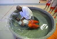 Inmate baptism inside the Albemarle Charlottesville Regional Jail. Photo/Andrew Shurtleff
