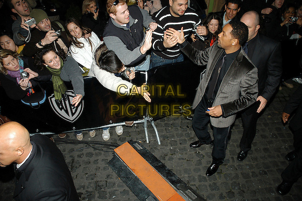 "WILL SMITH & FANS.Premiere of ""I Am Legend"", Rome, Italy..January 9th, 2008.full length grey gray suit jacket goatee facial hair shaking hands .CAP/CAV.©Luca Cavallari/Capital Pictures."