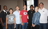 NWA Democrat-Gazette/CARIN SCHOPPMEYER Brian Williams and Lindsey Gobus (from left), Jody Johnson, Will Brandt, Eric Berry, Kansas City Chiefs free safety, and Nichole Simpson and Nathan Stevens visit at the VIP rececption for the All-Star Tailgate Party on June 10.