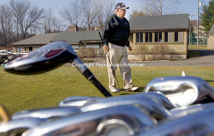 SOUTHBURY, CT. 19 March 2012-031912SV04-Rick Abbot of Southbury gets ready to tee off at the Pomperaug Golf Club in Southbury Monday. Abbot was enjoying the warm weather by golfing with friends..Steven Valenti Republican-American
