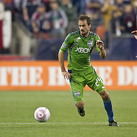 Seattle Sounders forward Roger Levesque (24) controls the ball at midfield. In a Major League Soccer (MLS) match, the Seattle Sounders FC defeated the New England Revolution, 2-1, at Gillette Stadium on October 1, 2011.