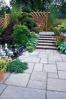 Bluestone paver patio with inlaid chess set, plantings, hot tub, steps, levels, arbor, patio set 37713