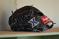 The Rawlings glove used by Greg Jacknewitz (not pictured) of the Xavier Musketeers sits on a shelf in the dugout prior to the game against the Penn State Nittany Lions at Coleman Field at the USA Baseball National Training Center on February 25, 2017 in Cary, North Carolina. The Musketeers defeated the Nittany Lions 10-4 in game one of a double header. (Brian Westerholt/Four Seam Images)