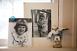 photos of Margaret B. Jones as a young girl sit on the window sill in the kitchen of her  home in Eugene, Oregon along with an American Indian Kachina doll.