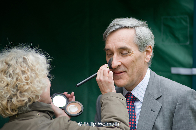 Conservative MP John Redwood is made-up before being interviewed by Sky News on College Green, Westminster, as politicians from the three main parties negotiate following an indecisive result in the 2010 General Election.