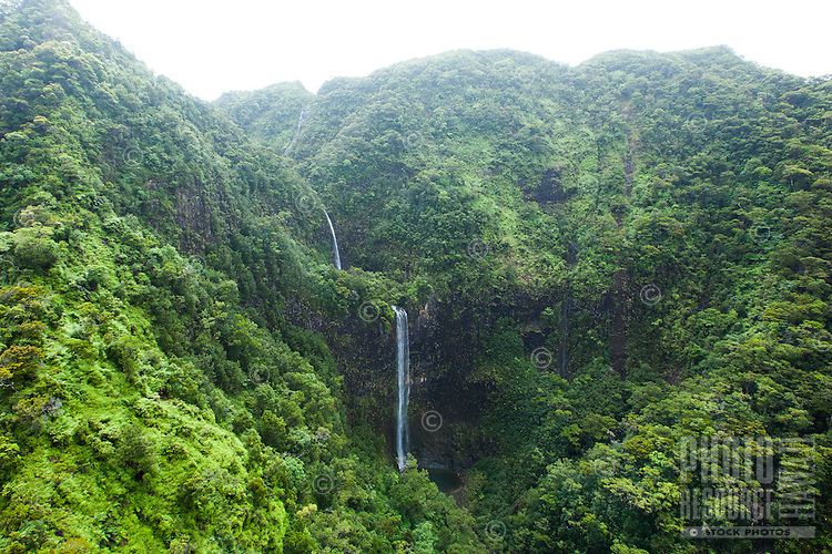 An aerial view of three waterfalls on Kaua'i.