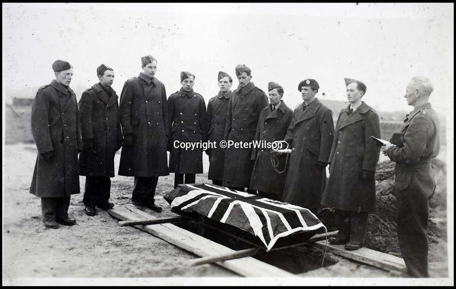 BNPS.co.uk (01202 558833)<br /> Pic: PeterWilson/BNPS<br /> <br /> The burial of a British prisoner.<br /> <br /> A fascinating photo album has to come to light to reveal what went on inside a German POW camp - including stage shows in drag.<br /> <br /> The Stalag Luft IV B album was compiled by British prisoner David Courtney, of 102 Squadron, whose Halifax was shot down near Berlin on January 20, 1944.<br /> <br /> One of the photos shows the funeral of a British soldier who was assassinated by the German guards, although they have taken part in the ceremony by lifting their guns above the coffin.<br /> <br /> Another shows a theatre performance put on by inmates where the performers were dressed as women to keep up morale.
