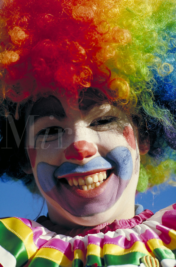 TEEN IN TRADITIONAL CLOWN COSTUME. TEEN GIRL. SAN FRANCISCO CALIFORNIA USA.