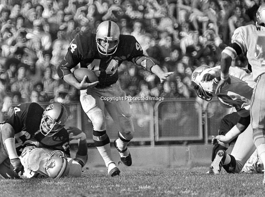Oakland Raider Marv Hubbard running, gets block from George Buehler..(1973 photo/Ron Riesterer)