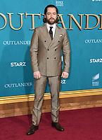 "13 February 2020 - Los Angeles, California - Richard Rankin. ""Outlander"" Season 5 Los Angeles Premiere held at the Hollywood Palladium. Photo Credit: Birdie Thompson/AdMedia"