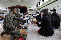 Capt. Vieet Rajan, III Marine Expeditionary Force, speaks with survivors at a shelter facility located inside Watariha Elementary School, Ishinomaki city, Miyagi Prefecture, Japan, March 23. Rajan accompanied John V. Roos, U.S. ambassador to Japan and Adm. Robert F. Willard, commander of U.S. Pacific Command, as they assisted in the delivery of relief supplies to displaced citizens. Since March 12, Marines have delivered food, fuel, water and supplies to disaster-stricken areas near Sendai as part of Operation Tomodachi. (Photo: by Lance Cpl. Steve Acuff)
