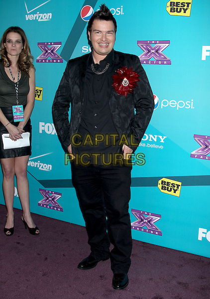 "Jason Brock.""The X Factor"" Season 2 Finalists Party held at The Bazaar at The SLS Hotel Beverly Hills, Beverly Hills, California, USA..November 5th, 2012.full length black suit jacket red corsage flower jeans denim.CAP/ADM/RE.©Russ Elliot/AdMedia/Capital Pictures."