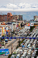 A panoramic view of snow covered peaks of the Andes mountains, with a highway traffic jam in the foreground, is seen in the city of El Alto, Bolivia, 10 February 2014. El Alto, the highest urban metropolis in the world, lies 4150 metres above sea level. During the last decades, rapid population growth together with migration from the rural zones have changed El Alto into the largest city in Latin America with prevalent indigenous population, reaching 1 million inhabitants in 2012.