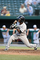 Dayton Dragons designated hitter Jamodrick McGruder (4) squares to bunt during a game against the South Bend Silver Hawks on August 20, 2014 at Four Winds Field in South Bend, Indiana.  Dayton defeated South Bend 5-3.  (Mike Janes/Four Seam Images)