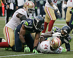 Seattle Seahawks  linebacker Bobby Wagner and free safety Earl Thomas look at San Francisco 49ers running back Anthony Dixon at CenturyLink Field in Seattle, Washington on September 15, 2013. The Seahawks beat the 49ers 29-3. ©2013. Jim Bryant Photo. ALL RIGHTS RESERVED.