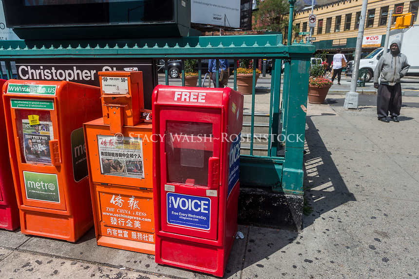 New York, NY, USA. 23rd Aug, 2017. An empty Village Voice newspaper box sadly waits in Sheridan Square to be refilled. On Tuesday, August 22, Peter D Barbey announced the 62 year old alternative weekly newspaper would cease publication of its print edition. An online edition will still be available via the internet CREDIT: Credit: Stacy Walsh Rosenstock/Alamy Live News