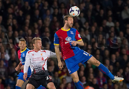 05.05.2014  London, England. Crystal Palace forward Glenn Murray (17) and Liverpool midfielder Lucas Leiva (21) during the Barclays Premier League match between Crystal Palace and Liverpool from Selhurst Park