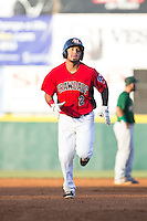 Eduard Pinto (2) of the Hickory Crawdads rounds the bases after hitting a 2-run home run against the Savannah Sand Gnats at L.P. Frans Stadium on June 15, 2015 in Hickory, North Carolina.  The Crawdads defeated the Sand Gnats 4-1.  (Brian Westerholt/Four Seam Images)