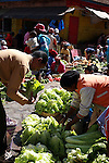 A woman selling salad to her customer at the Analakely market in Antananarivo in Madagascar