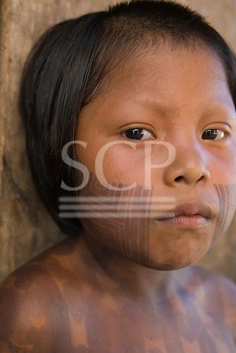 Mato Grosso State, Brazil. Aldeia Piaracu; Kayapo girl with face paint.
