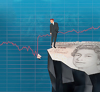 Businessman on cliff looking at broken piece of pound bill in line graph
