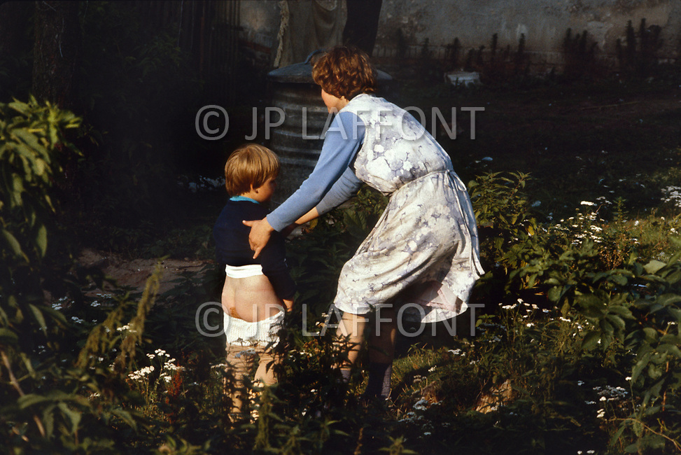 Poland, September, 1981 - A woman and her son in the Kolno region.