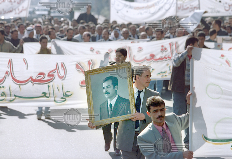 A pro Saddam Hussein demonstraion in the centre of Baghdad, while UN weapons inspectors  (February 1998) look for WMDs (weapons of mass destruction). The UNSCOM weapons inspectors left Iraq later that year.<br /> <br /> <br /> <br /> ©Fredrik Naumann/Felix Features