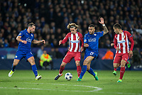 Antoine Griezmann of Club Atletico de Madrid battles Danny Simpson of Leicester City as Danny Drinkwater (left) of Leicester City & Angel Correa (right) of Club Atletico de Madrid look on during the UEFA Champions League QF 2nd Leg match between Leicester City and Atletico Madrid at the King Power Stadium, Leicester, England on 18 April 2017. Photo by Andy Rowland.