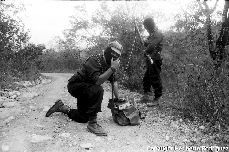 Subcomandante Marcos commnicates by radio with his soldiers in a  road close to  the Zapatista stronghold of Prado Pacayal, in southern state of Chiapas, March 22, 1994.  Photo by Heriberto Rodriguez