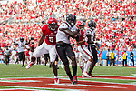 Deebo Samuel (1) of the South Carolina Gamecocks scores a touchdown on a 6-yard pass play during first half action against the North Carolina State Wolfpack in the Belk College Kickoff at Bank of America Stadium on September 2, 2017 in Charlotte, North Carolina.  The Gamecocks defeated the Wolfpack 35-28.  (Brian Westerholt/Four Seam Images)