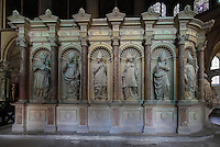 Statues of the peers of France, on the Tomb of Saint Remi, in the chancel of the Basilique Saint Remi or Abbey of St Remi, 11th century, Romanesque, Reims, France. The tomb of Archbishop Saint Remi, 440-533, who converted Clovis, the King of the Franks, to Christianity in 496 AD, is carved with Renaissance statues of the peers of France and surrounded by a 17th century enclosure. The original 16th century tomb was destroyed in the French Revolution and much of this present version dates to 1847. The abbey is a UNESCO World Heritage Site. Picture by Manuel Cohen