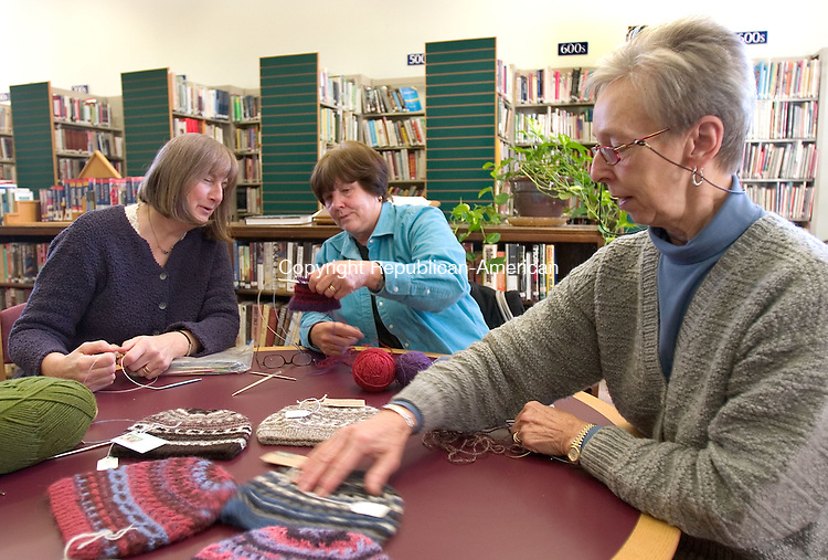 THOMASTON, CT. 01 November 2010-110110SV02--From left, Cindy Killian of Thomaston and Penny Mullen of Southwind Farms Alpaca Farm in Watertown learn a new knitting technique from Louise Jackson of Thomaston at the Thomaston Library in Thomaston Monday. The small group got together at the library to share techniques.  They were learning how to knit more than one color with 2 circular needles. Jackson sells her knitted hat at the farm in Watertown.<br /> Steven Valenti Republican-American