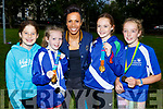 Labhraigh Costello, Rachel Mulgrew, Rachel O'Mahoney and Laura Falvey (Abbeydorney) with Olympian, Dame Kelly Holmes who visited the Harriers Running Club on Thursday.