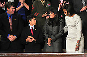 First lady Michelle Obama, right, and the Green family of Tucson, Arizona prior to United States President Barack Obama delivering his State of the Union Address to a Joint Session of Congress in the U.S. Capitol in Washington, D.C. on Tuesday, January 25, 2011.  From left to right: John Green, Dallas Green, Roxanna Green, and Michelle Obama..Credit: Ron Sachs / CNP.(RESTRICTION: NO New York or New Jersey Newspapers or newspapers within a 75 mile radius of New York City)