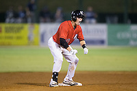 Brett Austin (20) of the Kannapolis Intimidators celebrates on second base after hitting a walk-off 2-run double in the bottom of the ninth inning against the Asheville Tourists at Intimidators Stadium on June 25, 2015 in Kannapolis, North Carolina.  The Intimidators defeated the Tourists 9-8.  (Brian Westerholt/Four Seam Images via AP Images)