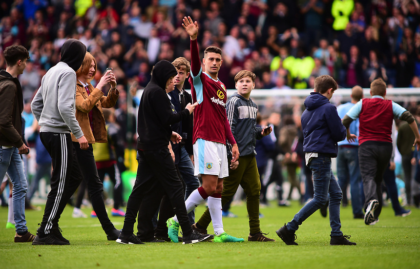 Burnley's Matthew Lowton is surrounded by fans at the final whistle<br /> <br /> Photographer Andrew Vaughan/CameraSport<br /> <br /> The Premier League - Burnley v West Ham United - Sunday 21st May 2017 - Turf Moor - Burnley<br /> <br /> World Copyright &copy; 2017 CameraSport. All rights reserved. 43 Linden Ave. Countesthorpe. Leicester. England. LE8 5PG - Tel: +44 (0) 116 277 4147 - admin@camerasport.com - www.camerasport.com