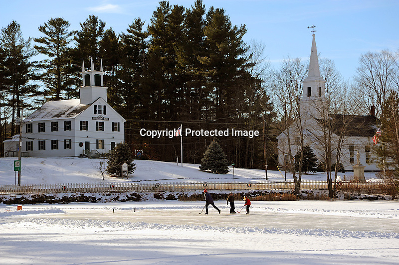 Ice Skaters Having Fun on the Pond in the Village of Marlow, New Hampshire