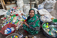 Bangladesh, Khulna, Sonadanga sweeper colony. Most of these people living in this slum are Dalit Hindu, or the untouchable caste working as sweepers and toilet cleaners. There are about 5.5 million Dalit across the country, they are most neglected caste in society. Amirun Nesa sorting through garbage and recyclying with her husband. Model released.